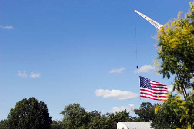 American flag hanging from a crane in Fredrick Maryland
