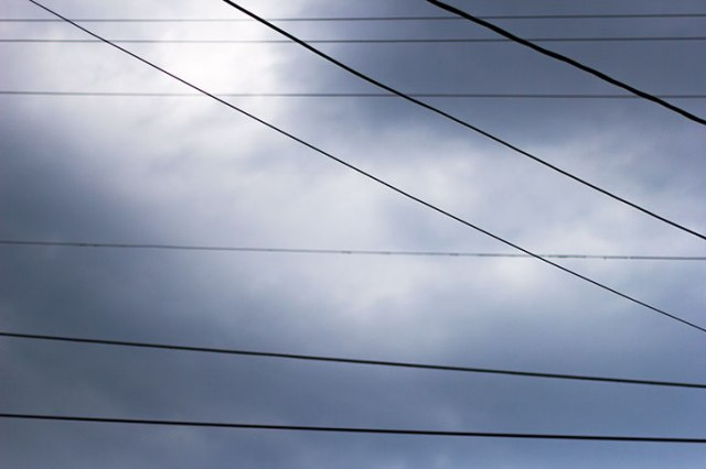 Power lines and stormy clouds